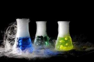 science experiment beakers with dry ice filling them